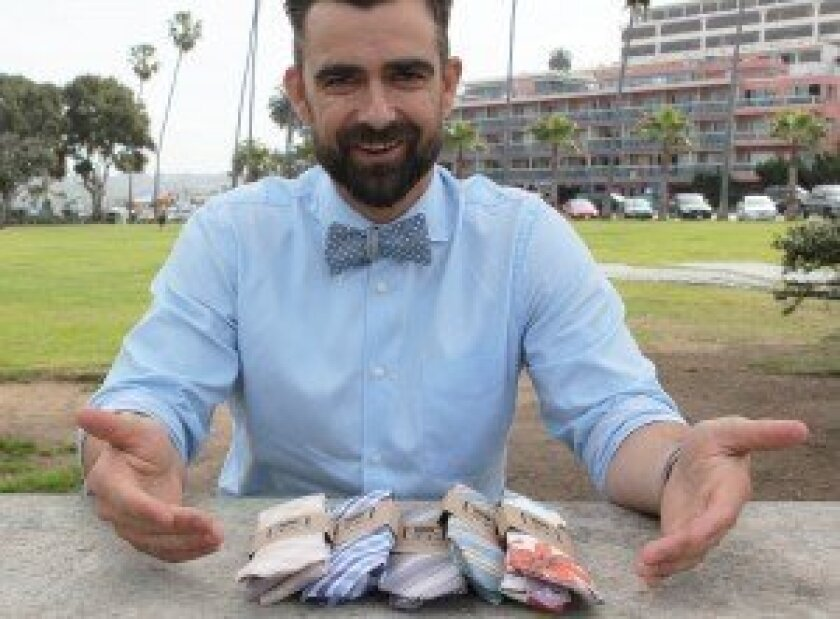La Jolla Shores resident and businessman Zach 'ZB' Barnhorst displays some of the neckties also available through his company, ZB Savoy Bowtie Co.