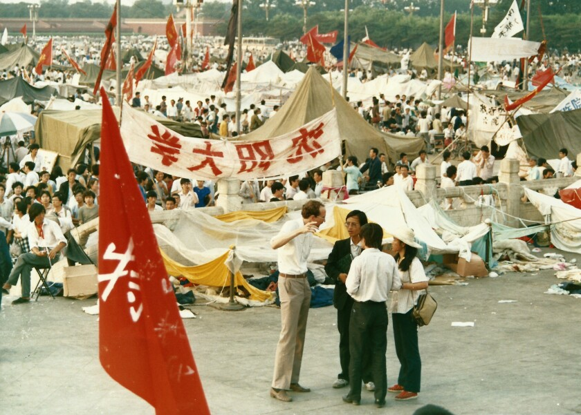 Reporter David Holley shown interviewing people in Tiananmen Square during the seven weeks of protes