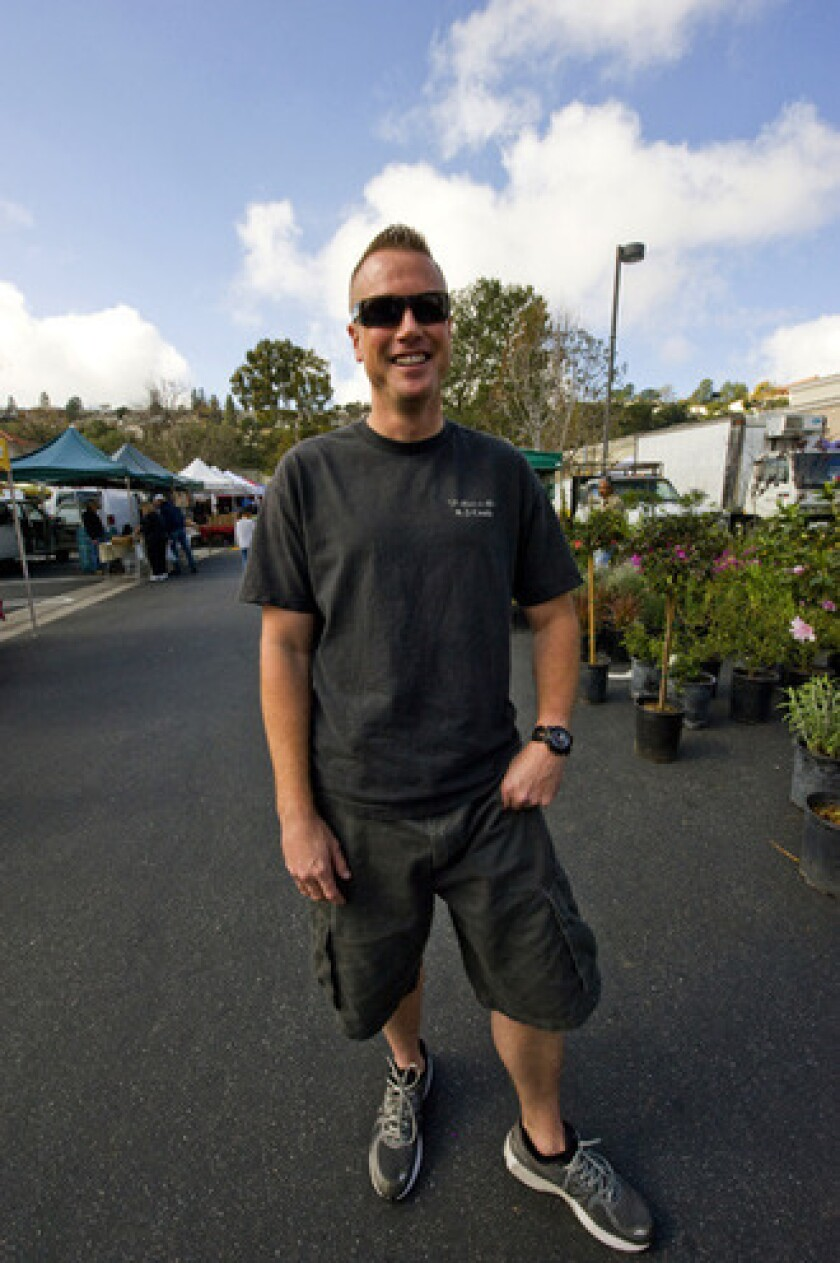 Brian Weiss, manager of the Palos Verdes farmers market, served in the Marine Corps in Afghanistan and East Africa.