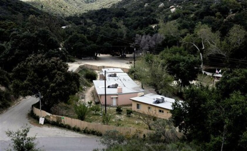 An exterior overview of the Kkottongnae Retreat Camp is shown Wednesday April 8, 2009 in Temecula, Calif. Earlier, a 69-year-old gunman opened fire at this remote Korean Christian retreat, killing a woman and wounding her husband before he was beaten and disarmed by a couple he also tried to shoot,