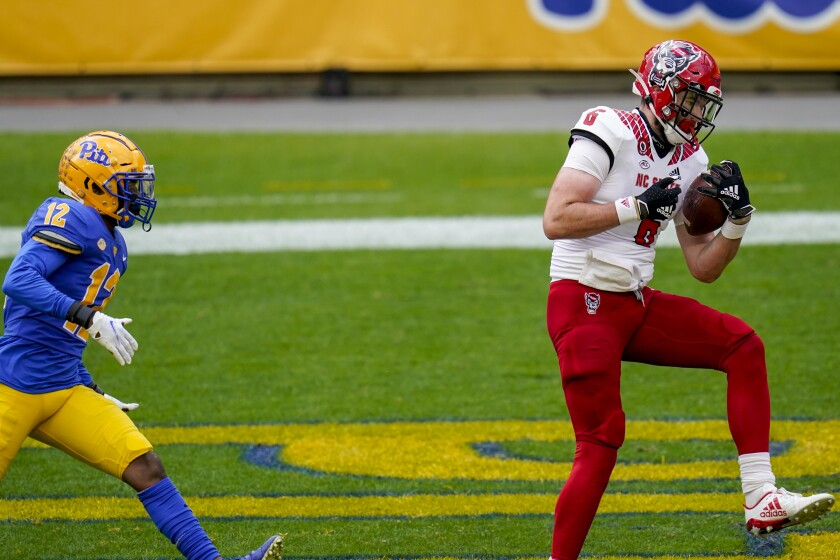 North Carolina State tight end Cary Angeline (6) makes a catch for a touchdown past North Carolina State cornerback Devan Boykin (12) in the first half of an NCAA college football game, Saturday, Oct. 3, 2020, in Pittsburgh. (AP Photo/Keith Srakocic)