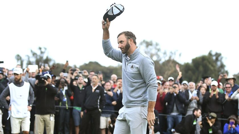Dustin Johnson acknowledges the crowd after winning the Genesis Open.