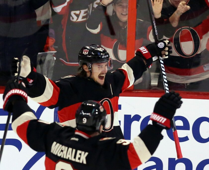 Ottawa Senators' Erik Karlsson (65) celebrates his goal against the Tampa Bay Lightning with teammate Milan Michalek (9) during the the first period of an NHL hockey game, Thursday, Jan. 30, 2014 in Ottawa, Ontario. (AP Photo/The Canadian Press, Fred Chartrand)