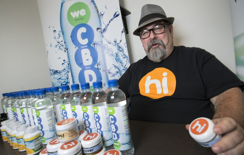 Hal Lewis, national sales director for Cannabis Sativa Inc., with Hi-brand cannabis balm and other products.