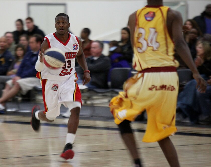 San Diego Sol guard Richie Williams dribbles the ball down court during a game against the Shizuoka Gymrats on Saturday, February 12, 2011 at Alliant University in Scripps Ranch.