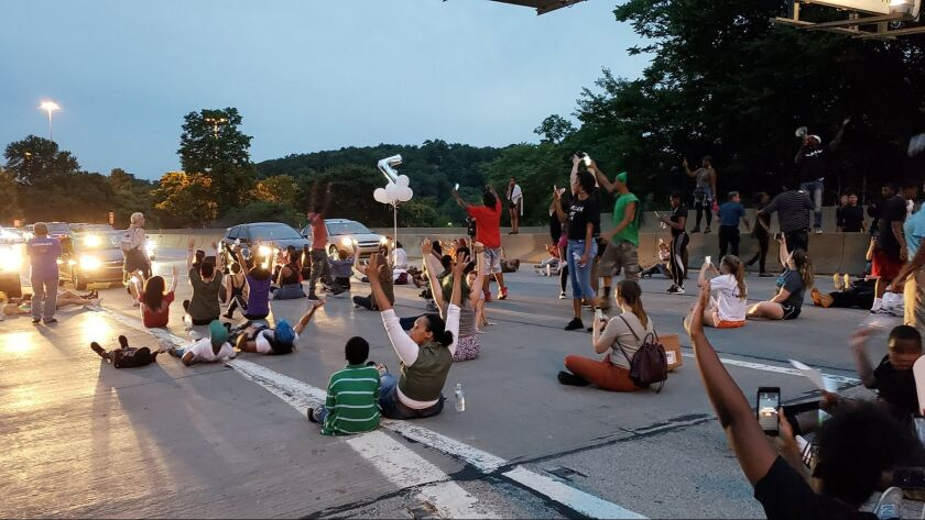 People block on Interstate 376 near Pittsburgh to protest the shooting death of Antwon Rose.