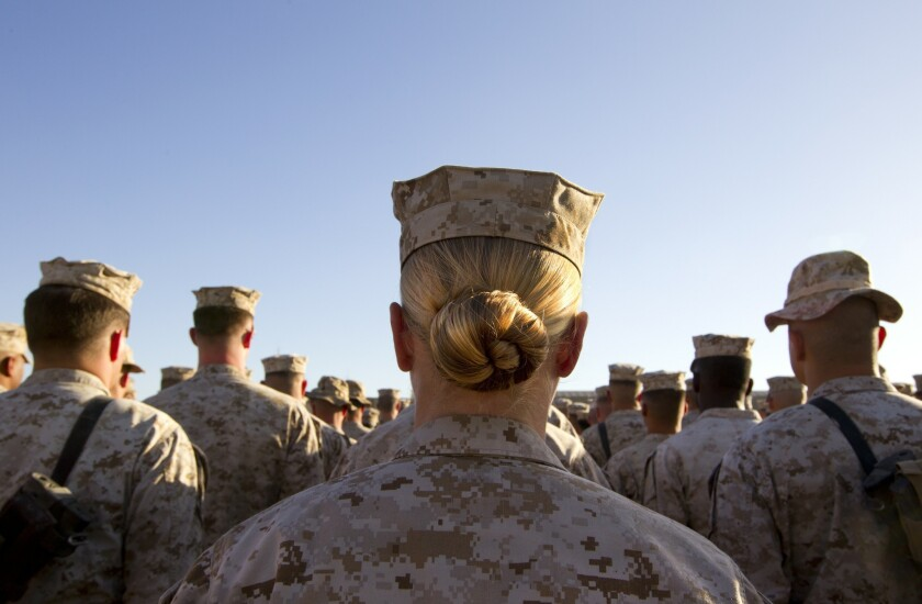 A female marine stands in formation along with her male compatriots on November 10, 2010, at Camp Delaram in Helmand province, Afghanistan.