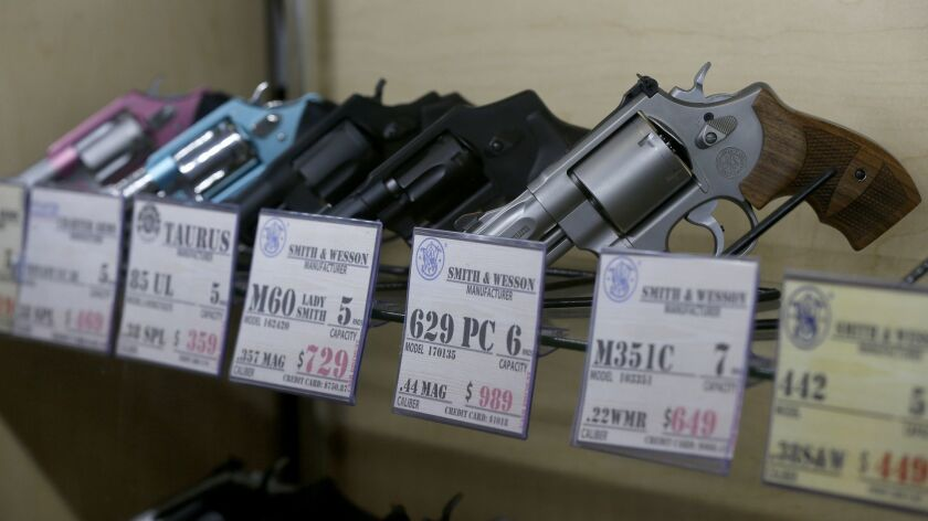A federal law barring immigrants who are in the country without authorization does not violate the 2nd Amendment right to bear arms, an appeals court panel ruled Tuesday. Above, guns for sale at a store in the City of Industry.