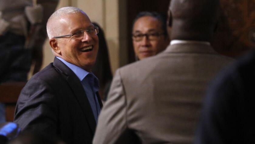 LOS ANGELES, CA - DECEMBER 11, 2018 - - Los Angeles City Councilman Mike Bonin, left, smiles after t
