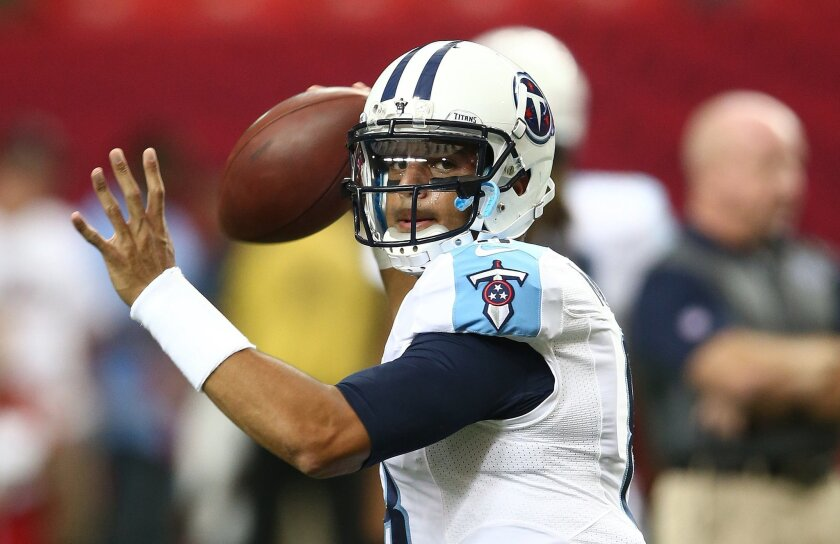 FILE - In this Aug. 14, 2015, file photo, Tennessee Titans quarterback Marcus Mariota warms up before an NFL football preseason game against the Atlanta Falcons in Atlanta. Tennessee rookie quarterback Marcus Mariota finally is ready for his home debut this preseason. It won't be easy against the St. Louis defense in a nationally televised game Sunday night, Aug. 23, 2015. (AP Photo/John Bazemore, File)