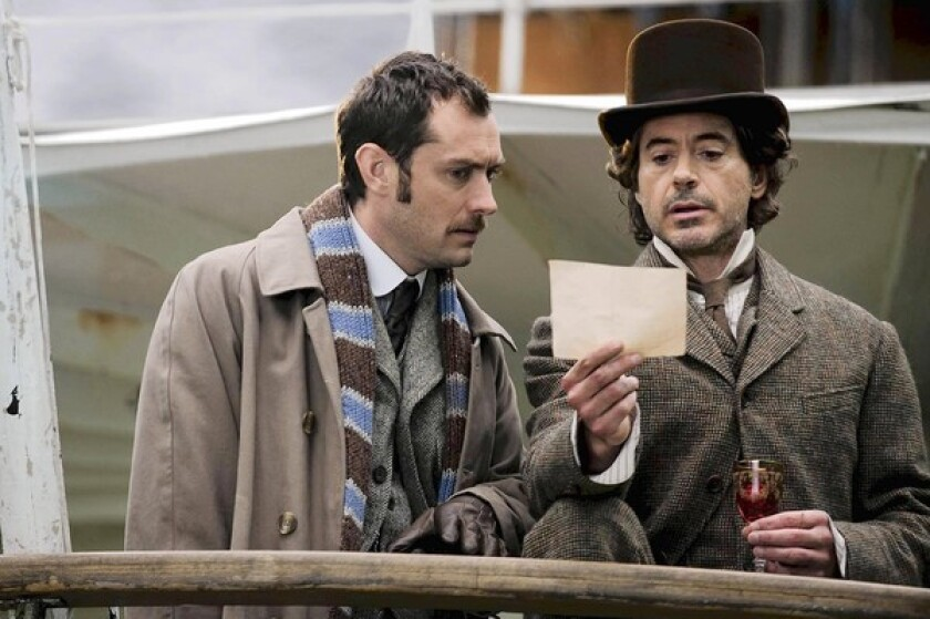 "Jude Law, left, as Dr. Watson, and Robert Downey Jr. as the eponymous detective in ""Sherlock Holmes: A Game of Shadows."""
