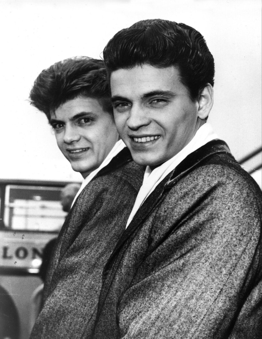 FILE - In this April 1, 1960 file photo, Phil, left, and Don of the Everly Brothers arrive at London Airport from New York to begin their European tour. Everly, who with his brother Don formed an influential harmony duo that touched the hearts and sparked the imaginations of rock 'n' roll singers for decades, including the Beatles and Bob Dylan, died Friday, Jan. 3, 2014. He was 74. Everly died of chronic obstructive pulmonary disease at a Burbank hospital, said his son Jason Everly. (AP Photo, File)