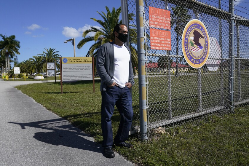 Kareen Troitino stands outside the Federal Corrections Institution, Friday, March 12, 2021, in Miami. Troitino, a local correction's officer union president, said that fewer than half of the facility's 240 employees have been fully vaccinated as of March 11. Many of the workers who refused had expressed concerns about the vaccine's efficacy and side effects, Troitino said. (AP Photo/Marta Lavandier)