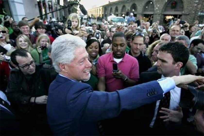 Former president Bill Clinton, campaigning for his wife, greets supporters in The Market in downtown Charleston, S.C.