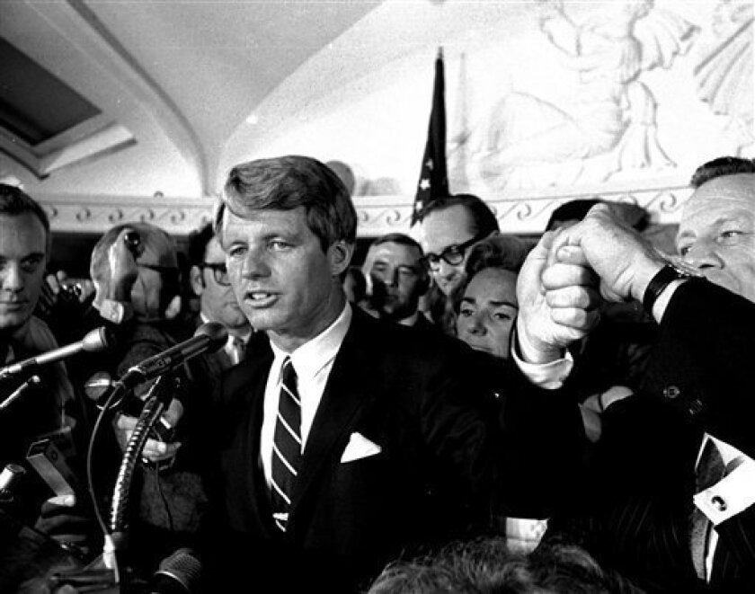 FILE - This June 5, 1968 file photo shows Sen. Robert F. Kennedy speaking at the Ambassador Hotel in Los Angeles, following his victory in the previous day's California primary election. A moment later he turned into a hotel kitchen corridor and was critically wounded. His wife, Ethel, is just behind him. The Los Angeles Police Department has apologized on Tuesday, March 2, 2010 to the family of Robert F. Kennedy for exhibiting the shirt, tie and jacket he wore when he was assassinated. (AP Photo/Dick Strobel, File)
