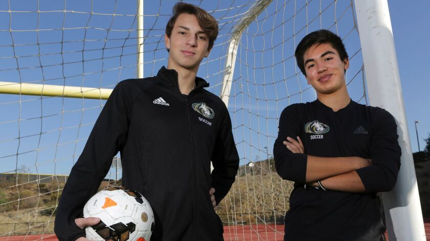 Sage Creek High School soccer players Kevin Cooke, left, and Aki Bajarano during practice at the sch