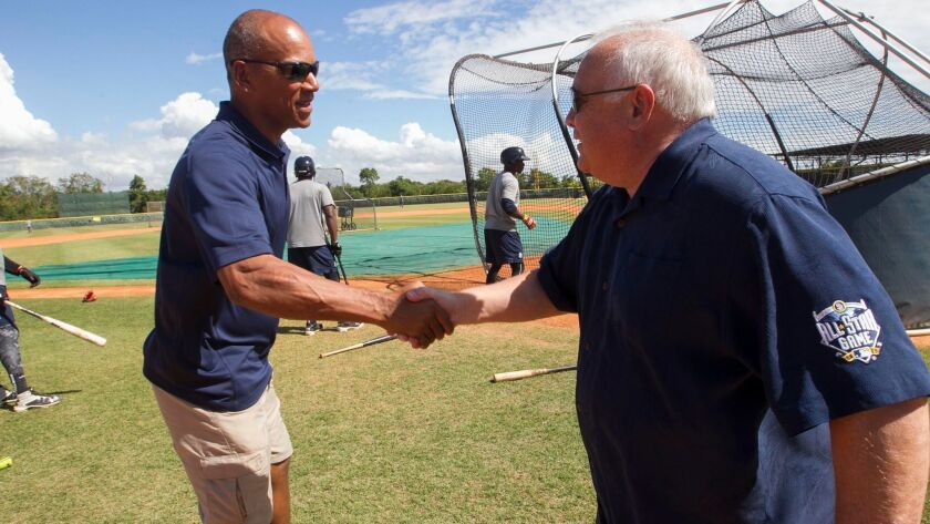 Moises Alou, left, greets Padres executive chairman Ron Fowler in February 2017 at the team's baseball academy in San Cristobal, Dominican Republic. Alou faced Hall of Famer Trevor Hoffman on the first night the signature song 'Hells Bells' played.