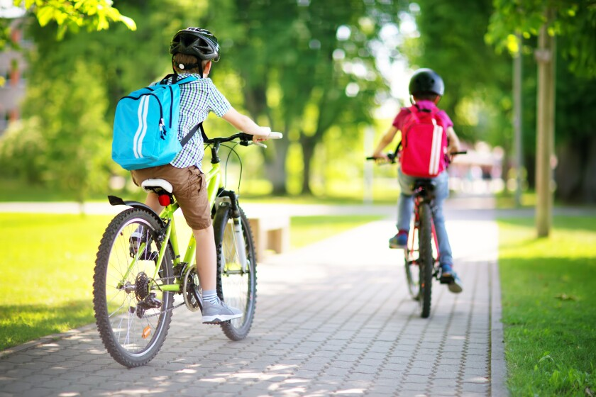 students riding bicycles