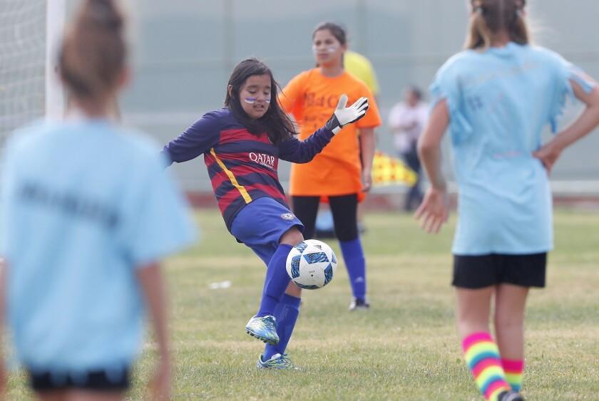 Costa Mesa Wilson Elementary goalkeeeper Emily Ebergenyi kicks the ball down field against Costa Mes