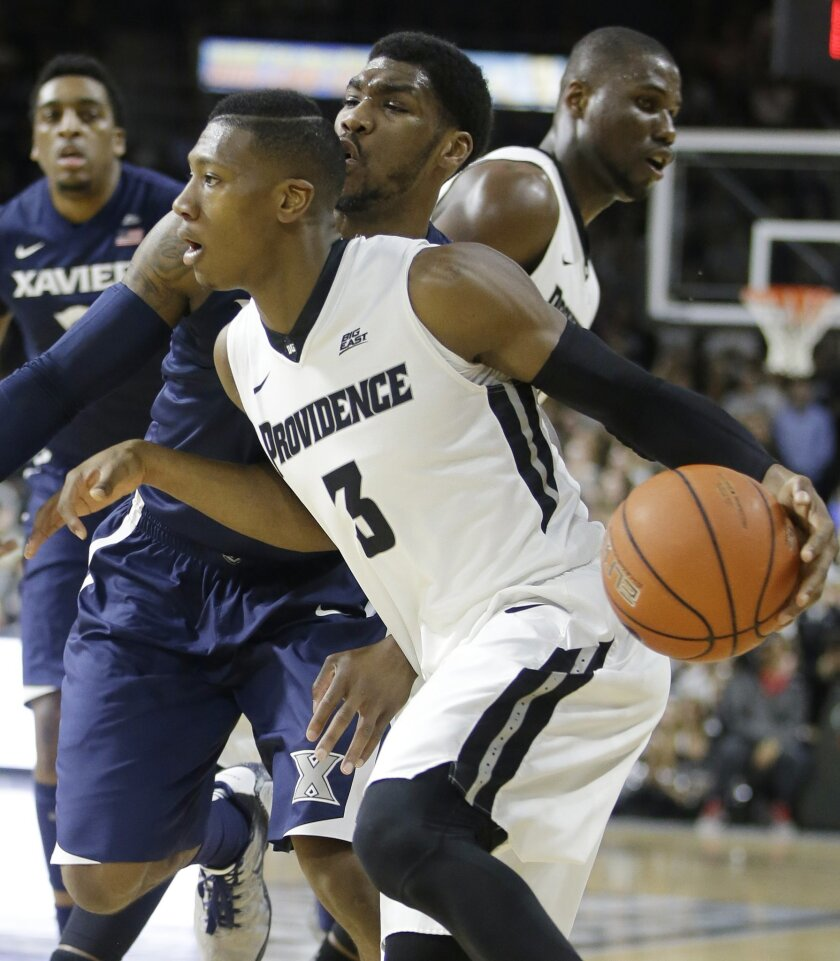 Providence guard Kris Dunn (3) drives around traffic toward the hoop during the first half of an NCAA college basketball game against Xavier, Tuesday, Jan. 26, 2016, in Providence, R.I. (AP Photo/Stephan Savoia)