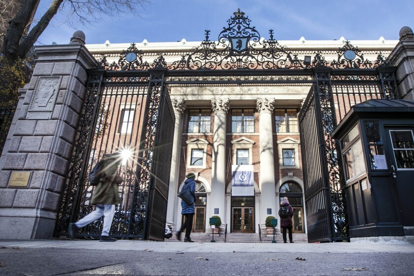 People enter the main gate to Barnard College, in New York's Upper West Side, Thursday, Dec. 12, 2019. An 18-year-old Barnard College freshman, identified as Tessa Majors, has been fatally stabbed during an armed robbery in nearby Morningside Park, sending shock waves through the college and wider Columbia University community. (AP Photo/Richard Drew)