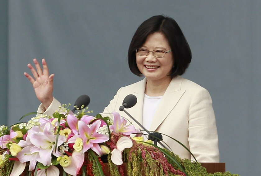 "FILE - In this file photo taken Friday, May 20, 2016, Taiwan's President Tsai Ing-wen waves as she delivers an acceptance speech during her inauguration ceremony in Taipei, Taiwan. A newspaper published by China's official news agency says the new president of rival Taiwan is more ""extreme"" in her politics because she's an unmarried woman lacking the emotional balance provided by romantic and family life. (AP Photo/Chiang Ying-ying, File)"
