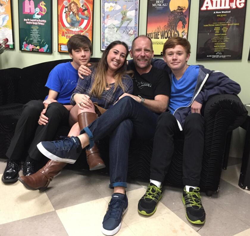 """J*Company Youth Theatre Artistic Director Joey Landwehr with 'The Wiz' cast members (from left) Riley Hull, Talia Israel and Brendan Dallaire. """"The Wiz"""" will be performed Jan. 13-29, 2017 in the Garfield Theatre at Jewish Community Center, 4126 Executive Drive, La Jolla."""