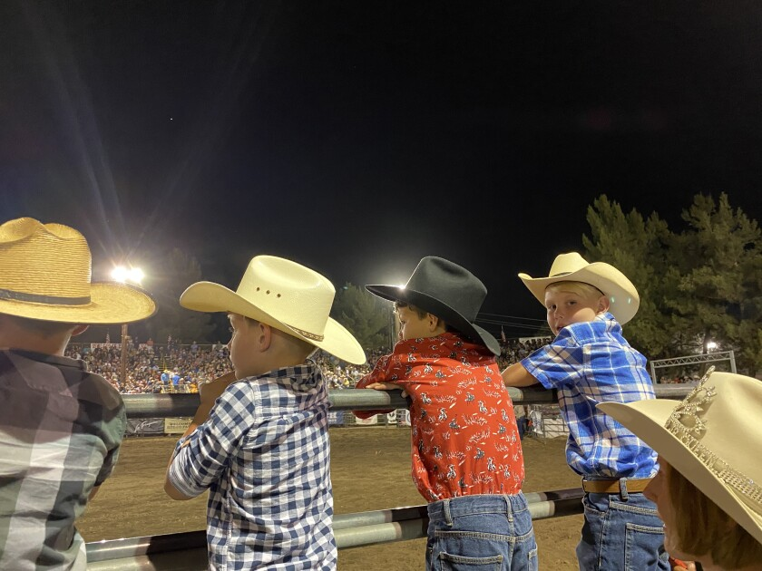 Mary Meurs Samaniego, the 2002 Ramona Rodeo Jr. Queen, at the Ramona Rodeo with son, Arie Samaniego, and Brody Ralls, right.
