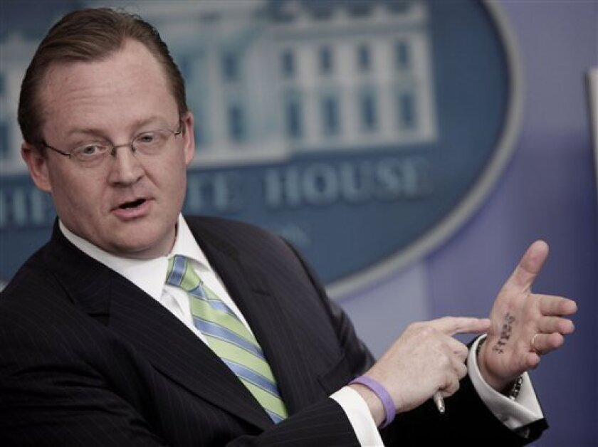 White House Press Secretary Robert points to the palm of his hand which he has written down notes to show members of the media during a press briefing at the White House, in Washington, Tuesday, Feb. 9, 2010. (AP Photo/Pablo Martinez Monsivais)