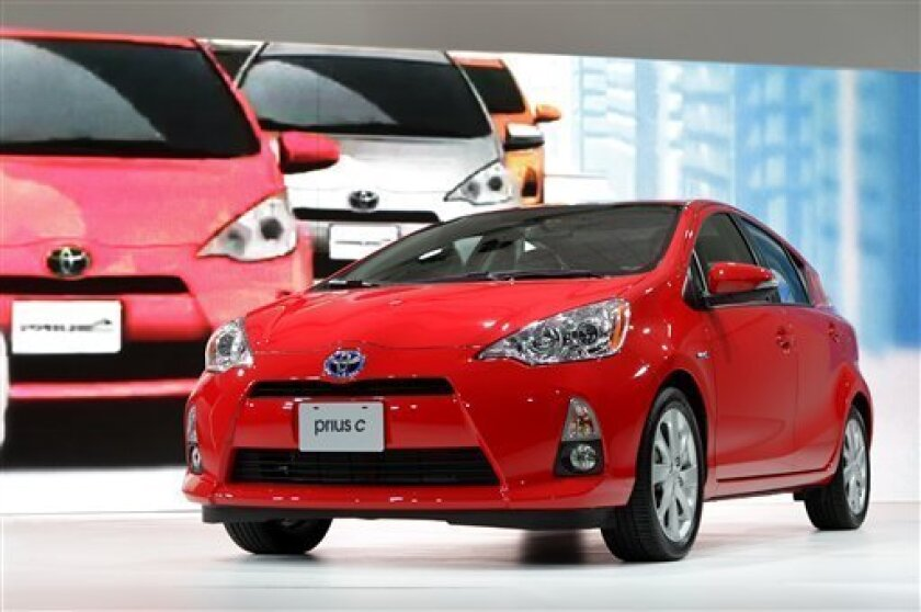 The 2013 Toyota Prius c debuts at the North American International Auto Show in Detroit, Tuesday, Jan. 10, 2012. (AP Photo/Paul Sancya)