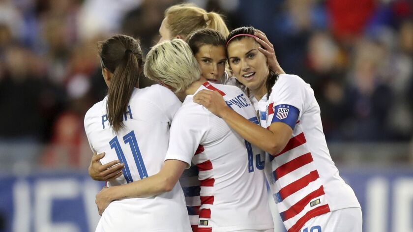 FILE - In this Tuesday, March 5, 2019, file photo, United States' Tobin Heath, second from right, is