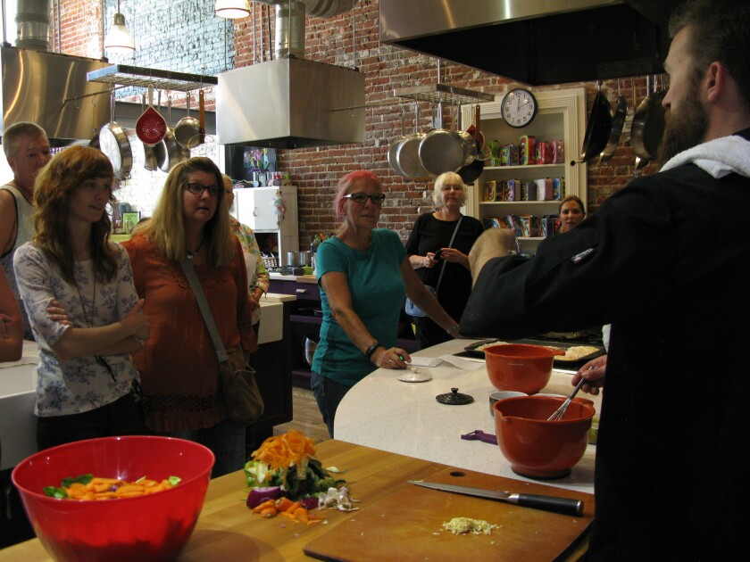 """Participants watch as Travis French prepares lunch during a My 420 Tours """"Cooking with Cannabis"""" class in Denver."""