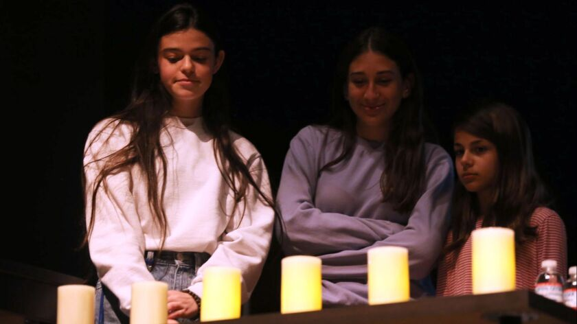 Six candles are lit for the six million who died during the Holocaust, during a March 28 talk at La Cañada High School 7/8.