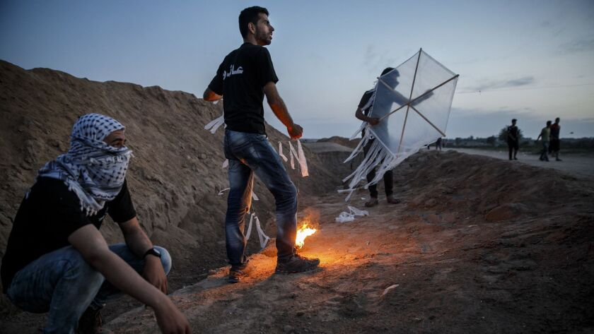 DEIR AL-BALA, GAZA STRIP -- WEDNESDAY, MAY 9, 2018: Palestinians test out their kites that carry tor