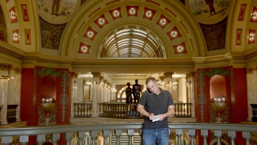 "Investigative journalist John S. Adams, seen in the Montana Capitol building, is the guide through the thicket of issues explored in the documentary ""Dark Money."""