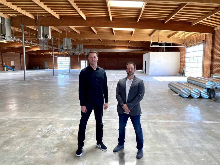 Rob Johnson, COO of Nerd Street Gamers, left, and John Fazio, Founder & CEO of Nerd Street Gamers, stand where Localhost Los Angeles will be built.