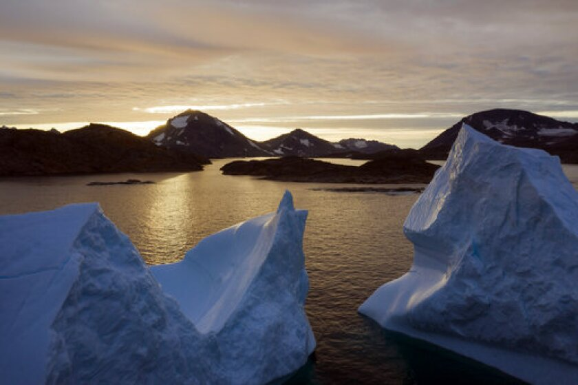 This 2019 file photo shows an aerial view of large Icebergs floating in Greenland.