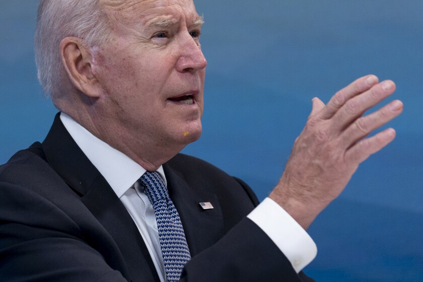 President Joe Biden has something small and yellow on his chin as he speaks during a meeting with governors to discuss ongoing efforts to strengthen wildfire prevention, preparedness and response efforts, and hear firsthand about the ongoing impacts of the 2021 wildfire season in the South Court Auditorium in the Eisenhower Executive Office Building on the White House Campus in Washington, Friday, July 30, 2021. An aide passed the president a note alerting him of something on his face and he wiped it away. (AP Photo/Andrew Harnik)