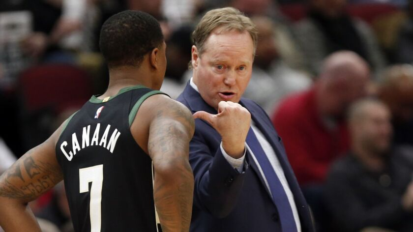 Milwaukee Bucks head coach Mike Budenholzer , right,speaks with guard Isaiah Canaan (7) during the s