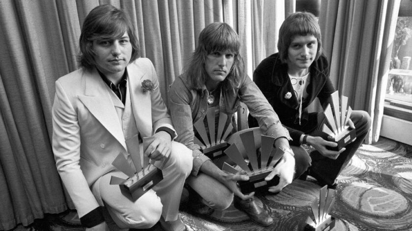 Emerson, Lake & Palmer co-founder Greg Lake (left), died Wednesday at 69 from cancer. He is shown in 1972 with Keith Emerson (center), who died earlier this year, and Carl Palmer.