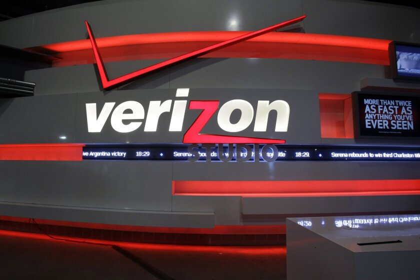 FILE - This April 7, 2013, file photo shows the Verizon studio booth at MetLife Stadium, in East Rutherford, N.J. Nearly 40,000 striking Verizon employees will return to work Wednesday, June 1, 2016, after reaching a tentative contract agreement that includes 1,300 new call center jobs, nearly 11 p
