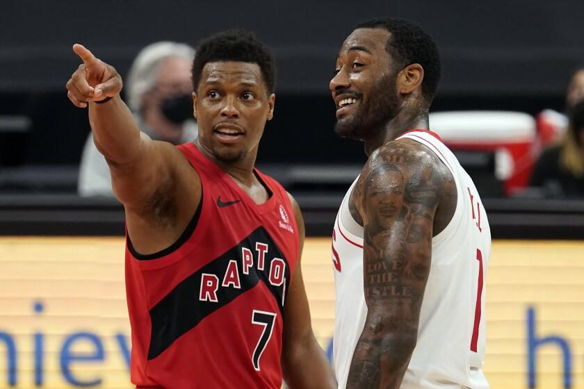 Toronto Raptors guard Kyle Lowry (7) talks to Houston Rockets guard John Wall (1) after an NBA basketball game Friday, Feb. 26, 2021, in Tampa, Fla. (AP Photo/Chris O'Meara)