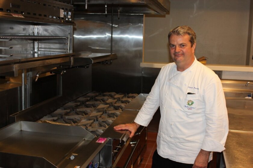 Chef Patrick Ponsaty in the restaurant's kitchen.