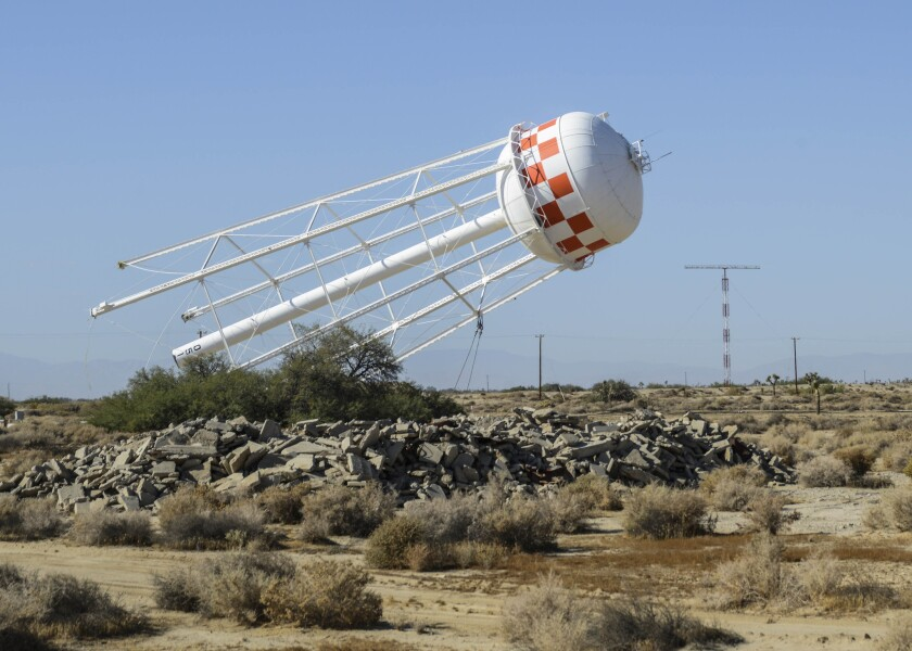 The South Base water tower, once a 160-foot landmark at Edwards Air Force Base, was demolished last week.