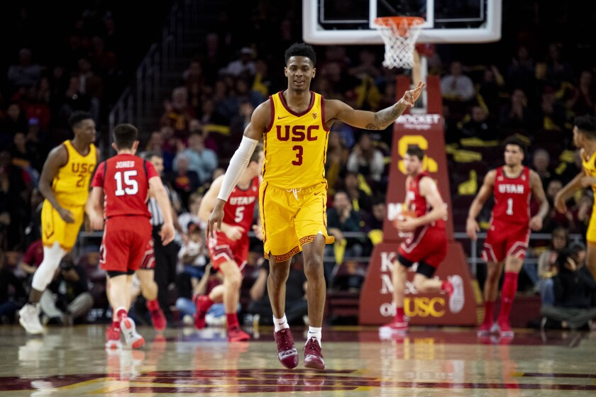 USC guard Elijah Weaver celebrates his three-point basket during the second half against Utah on Jan. 30 at the Galen Center.