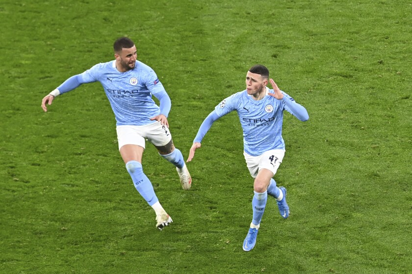 Manchester City's Phil Foden celebrates after scoring his side's second goal during the Champions League quarterfinal second leg soccer match between Borussia Dortmund and Manchester City at the Signal Iduna Park stadium in Dortmund, Germany, Wednesday, April 14, 2021. (Federico Gambarini/Pool via AP)