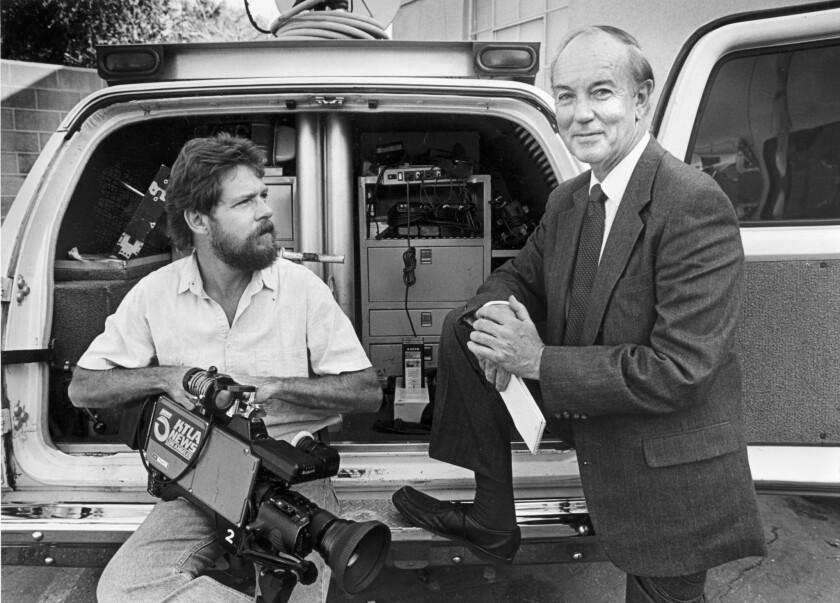 KTLA-TV Channel 5 reporter Stan Chambers, right, appears with cameraman Martin Clancy in 1987. Chambers, who was with the news station for more than six decades, died Friday. He was 91.