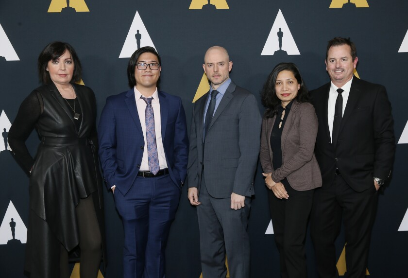 From left to right, Nicholl fellows Karen McDermott, Aaron Chung, Walker McKnight, Renee Pillai and Sean Malcolm pose at the Academy Nicholl Fellowships in Screenwriting Awards and Live Read at the Academy of Motion Picture Arts and Sciences Samuel Goldwyn Theater on Thursday, Nov. 7, 2019, in Beverly Hills, Calif. (Photo by Danny Moloshok/Invision/AP)