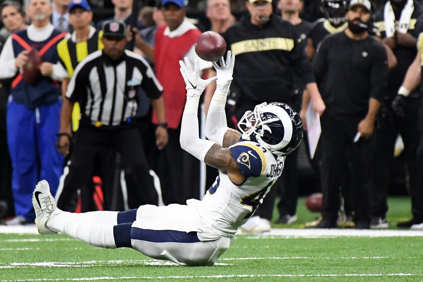 Rams safety John Johnson intercepts a pass by Drew Brees in overtime against the New Orleans Saints in the NFC championship game at the Superdome.