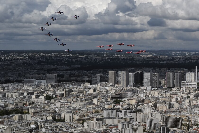 French Alpha jets of the Patrouille de France and the UK Royal red arrows aerobatic planes fly over west of Paris, Thursday, June 18, 2020 as part of commemoration for the 80th anniversary of Charles de Gaulle's radio appeal to his countrymen to resist Nazi occupation during WWII. French President Emmanuel Macron is traveling to London to mark the day that De Gaulle delivered his defiant broadcast 80 years ago urging his nation to fight on despite the fall of France. In a reflection of the importance of the event, the trip marks Macron's first international trip since France's lockdown amid the COVID-19 pandemic. (AP Photo/Francois Mori)